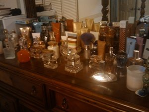 So... this is an old pic... I've added at least 10 bottles since this photo was taken... my name is Shera, and I'm a perfume addict!