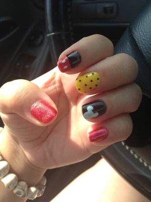 Disney inspired Mickey Mouse nails with polka dots and Mickey ears