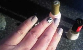 Revlon Stormy Canvas and animal print accent nail