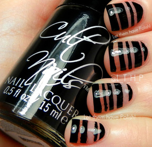 A manicure inspired by Sam of The Nailasaurus for the 31 day Challenge. The Black is Cult Nails in Nevermore.