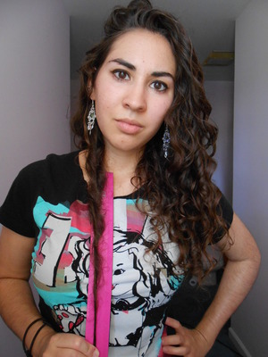 Plus summertime curls, thanks to some humidity and the Curly Girl Method. Originally a video thumbnail, hence the pose.