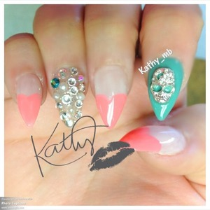 Small stiletto nails with coral heart shape tips. Skull and rhinestones from my wed-site  Www.iheartkathy.com
