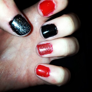 Red and black nail polish with glitter.