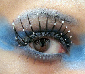 """Now that Winter is on its way out, I figured I would do a sort of """"Jack Frost"""" inspired look. I used Urban Decay Radium eyeshadow for the blue, MAC Pearlglide Liner in Petrol Blue, Sugarpill's Tiara in the center of the lid (not visible in this picture) and Sugarpill's Dewdrop Lashes. I used Urban Decay's Strip on the brows. A white cream product from Mehron on the waterline. My Primer was the Lorac Behind The Scenes Eye Primer. My bottom falsies are from Alcone Co."""