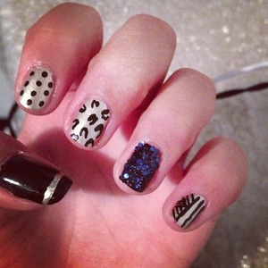 Creative  nails with black ,gold And some tiny balls used on only one nail. These nails are elegant and very easy to do!!! :)