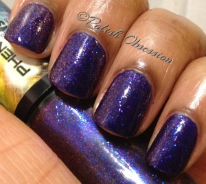 Blue and orange microglitter in a clear base  http://www.polish-obsession.com/2013/02/hits-phenomena-afterglow.html