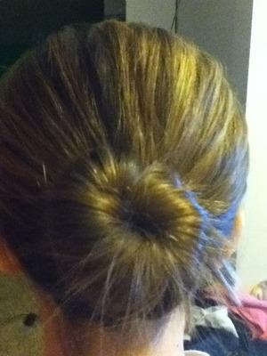 Ballerina bun. My hairs thin so it's not so big.