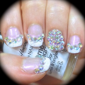 A Sparkly twist on a Classic French Manicure! If you are bored of your standard french tip manicure and want something to jazz it up a bit, then try using these colourful crystals to add some pizazz and pep!  Get all the embellishments and decorations I used here from the Born Pretty store http://bit.ly/ihBHUJ and use the code MIHW10 for 10% off your whole order!
