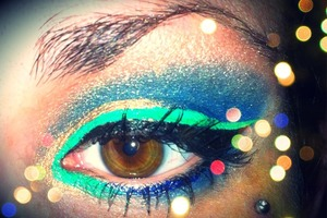 I really like using rich green and blue hues, and a dash of gold or shimmery sand doesn't hurt.
