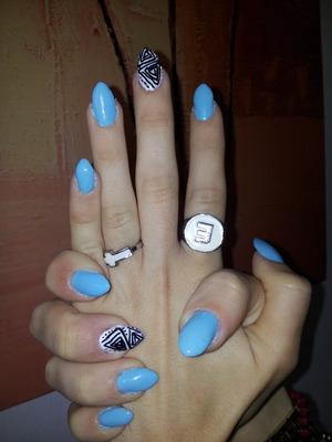 pastel sky blue stiletto nails with azdek print