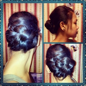 A little bump on top plus a twist and plait into a bun..