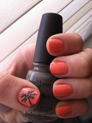 Used a fine nail art brush to create the palm tree