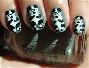 Panda Nails Nail tutorial & more photos here: http://www.swatchandlearn.com/nail-art-tutorial-panda-nails/