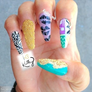 Stiletto nails with gold caviar and glitter