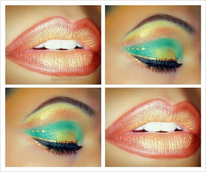 Eyes: Blends of Gold and greens. Lips: Red Orange with Gold Lipstick in center.