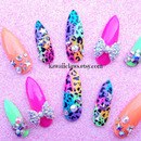 Neon Leopard with bows and stars Stiletto nails