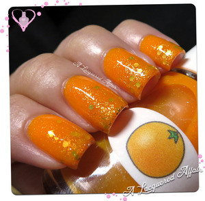 Gold glitter sandwiched between The Nail Junkie Orange, a neon jelly shimmer polish.
