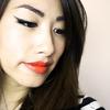 Winged Eyeliner and Bold Orange lips