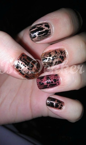 This super simple design requires 5 different shades of brown/gold and a light coat of OPI Shatter polish in black. When you are finished the design will resemble animal print!