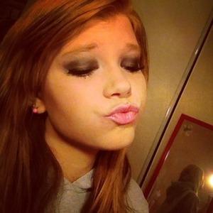 Black smokey eye with a pink lip