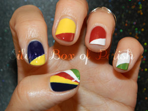Nail art inspired by the flag of Seychelles.