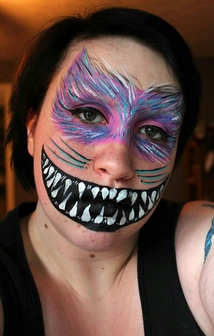 A cheshire cat inspired face paint