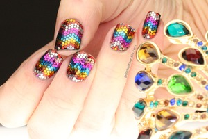 Each piece of glitter is hand placed to form a sparkly rainbow zig zag mani.   Full post here: http://www.polishallthenails.com/2013/01/my-most-complex-rainbow-glitter-mosaic.html