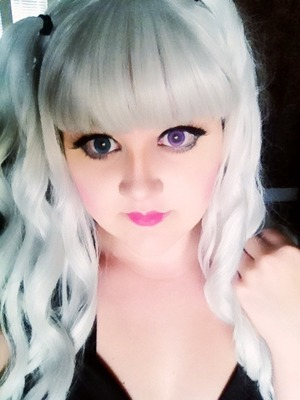 Simplified anime makeup, grey twin tail mermaid wig, and two toned eyes.