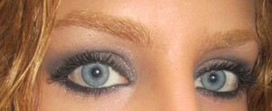 Mally Beauty shimmering taupe on lid, nolita navy in crease, broadway bronze as eyeliner and heavenly luminizer below brow..celebrate shadow on top of lid colors.