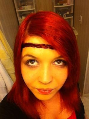 Braided bangs used as a head band(: