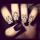 Matte finish leopard nails.
