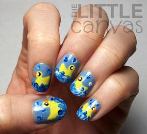 http://thelittlecanvas.blogspot.com/2013/01/rubber-ducky-nail-art-revisited.html