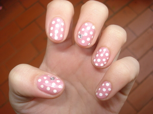 Even the simplest of polka dots look good in pink and rhinestones.