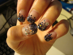 Simply a mix of small circular glitter pieces along with black diamond glitter pieces. Small gemstones are added to certain fingers. These are gel nails!  Others: Cost me $30.