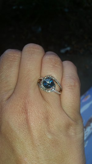 I got a new ring LeVian London Blue with white and chocolate diamonds is rose gold.....it's a Cinderella ring I love it. I had surgery and my honey suprised me with it today (: