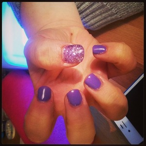 Purple gel nails with one glittery!