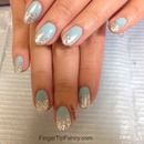 Baby blue nails with silver glitter tips