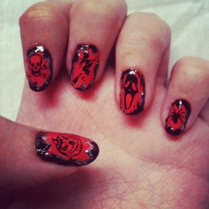 Stamped nails in black and orange with pumpkim, spider and skull.