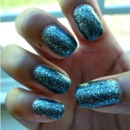 China Glaze Tinsel Town, a dark gray glitter polish <3