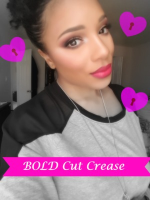 Bold pink cut creas with a blown out lower lash line andbold red lips