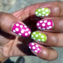 Pink & green nails with white dots & glitter.