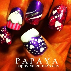 These are my moms nails! <3 Her birthday is Feb. 12 and so I wanted to give her something for both occasions! So she got a cupcake for her BDay and hearts for valentines day!  NYC New York Color - 133A Purple Pizzazz Frost Sinful Colors - #113 Dream On
