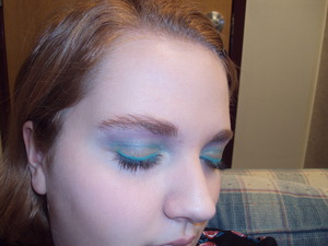 Green eyeshadow on the lid, blue in the base, purple on the brow bone. Teal eyeliner from HotTopic. That was my makeup today. :P
