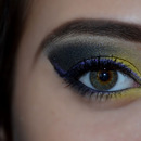 Yellow makeup with purple eyeliner