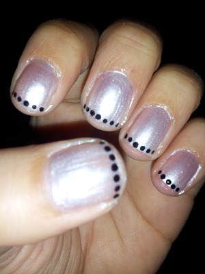 I used ciate polish in angel wings and dotted black dots on my finger tips using a kiss nail polish striped.  Did this for a wedding I went to.
