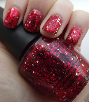 A 3D red glitter with silver accents of glitter