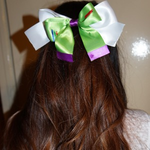 Check out my youtube channel if you want to see how to make your own Buzz Lightyear bow :)