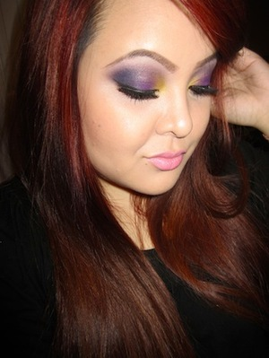 http://tinamarieonline.blogspot.com/2011/09/smokey-purple-with-pop-of-yellow.html