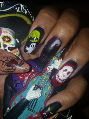 Hand painted by me on my own nails.  Used acrylic and tempera paints for the designs.   Hope you like!