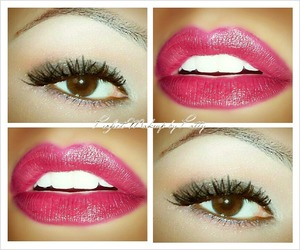Cranberry tinted lips and soft smokey eyes with shades of browns.